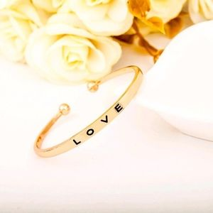 Love Engraved Open Bangle Bracelet in Gold